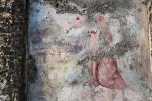In uno dei dipinti la Madonna protegge il casale da un braccio di lava - © pietronicosia.it